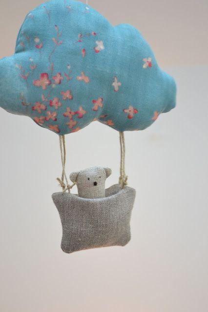 les pommettes du chat. Little bear softie in a hot air cloud softie.