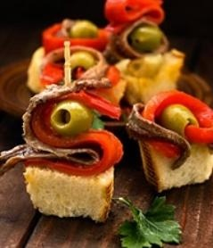 Origin of Tapas is Spain. They are little dishes meant to be eaten between main meals - between breakfast and lunch, between lunch and dinner and after the dinner during bar-hopping time. The history of tapas is very old.