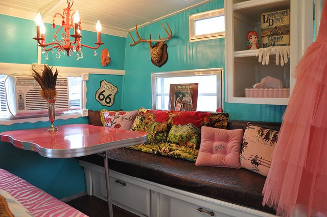 Vintage Travel Trailer Interiors | farm8.staticflickr.com. Love the wall paint, chandelier, and pillows.