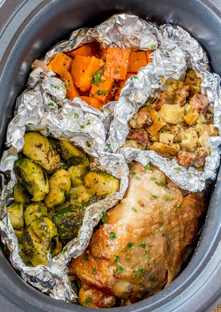 Slow Cooker Thanksgiving Dinner with tender turkey thighs, candied sweet potatoes, sausage stuffing and Brussels Sprouts cooked entirely in the Slow Cooker!