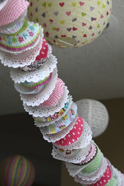 garland made from cupcake wrappers and doilies for a cupcake party