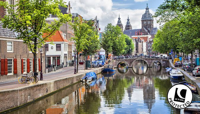 UK Holidays: Amsterdam, Netherlands: 2-3 Night Hotel Stay With Flights - Up to 36% Off for just: £69.00 Bikes, canals and coffee shops await; visit Amsterdam for 2-3 nights.      Stay at the King's Court Hotel, with an on-site bar and handy city location      Sleep tight in a modern en suite room with free Wi-Fi access      Walk along the beautiful canal paths and take in the narrow houses...