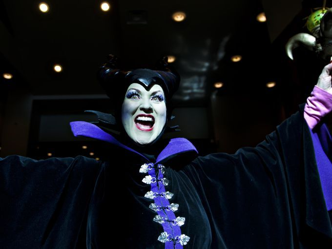 Diane Lynn steps into the light as Maleficent. Lynn dressed up with friends for the 2014 Phoenix Comicon at the Phoenix Convention Center on...