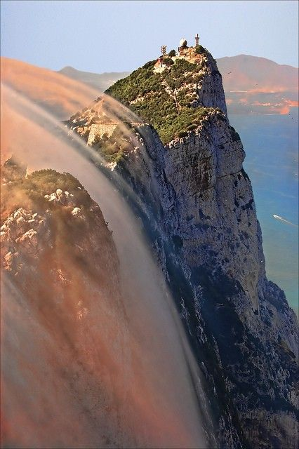 Clouds covering the walls of Gibraltar Rock, Spain | Most Beautiful Pages