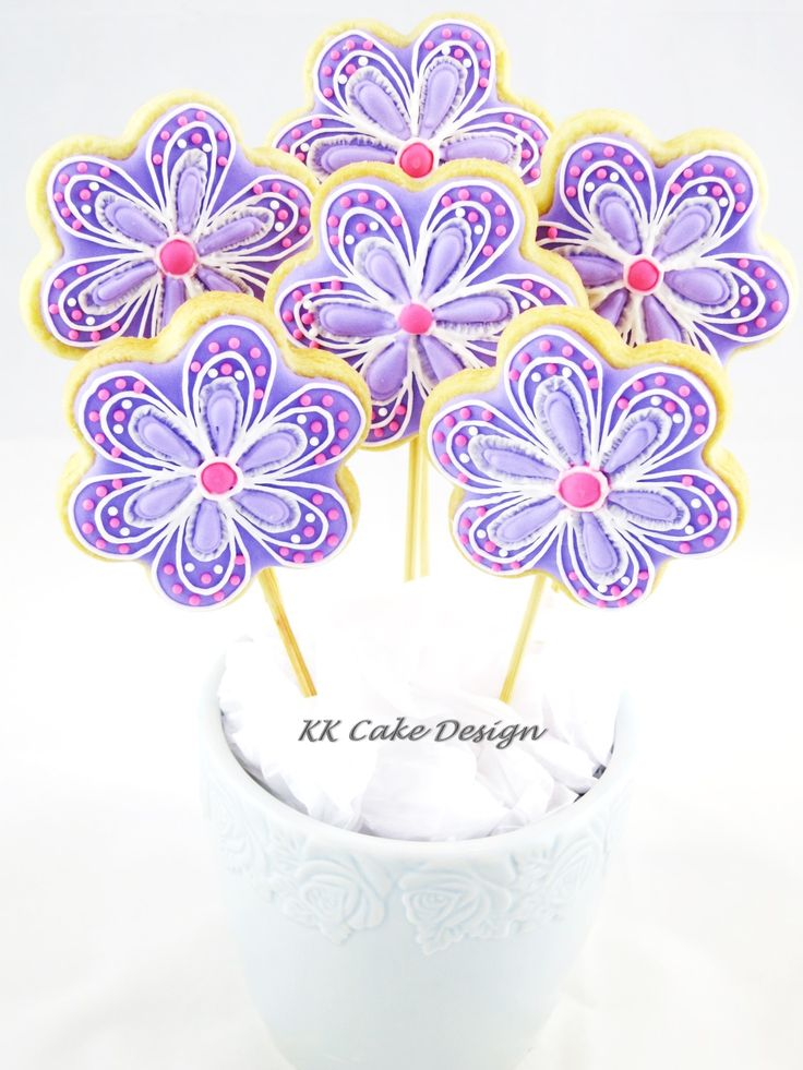 Floral arrangement. Vanilla butter cookies decorated with royal icing.