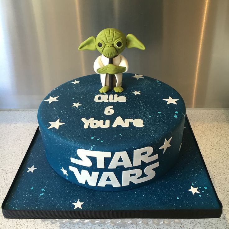 Star Wars and Yoda cake. Chocolate mud cake with milk chocolate ganache. Gumpaste and fondant figurine.
