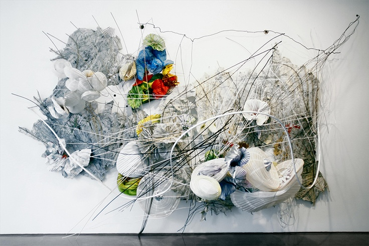 "Silver bells and cockel shells, 2010 by Judy Pfaff. Paper, wood, wire and rod, artificial flower, 86"" x 192"" x 62""."