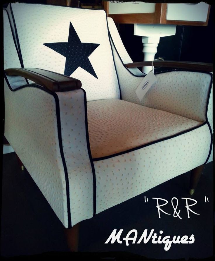 """""""R & R""""  One of our favourite chairs to come out of our workshop, this example has been covered in faux Ostrich hide with a black ostrich hide star in the backrest, with natural wooden arms and turned legs. This piece is a stunner to look at and arguably even better to sit in available in any fabric and colour variations."""