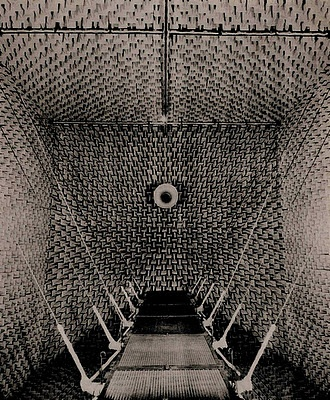"""Anechoic chamber at the Harvard Acoustics Research Laboratory. """"An anechoic chamber is also a kind of prosthesis, serving to eliminate sound reflections in a room. Bell Labs built the first one, and Harvard's Acoustics Research Laboratory also built one. (See Beranek's Box by Laci Videmsky for a short film on the anechoic chamber at Harvard). John Cage famously sat in Harvard's anechoic chamber for a period of time and emerged with a striking observation : I heard two sounds, one high and…"""