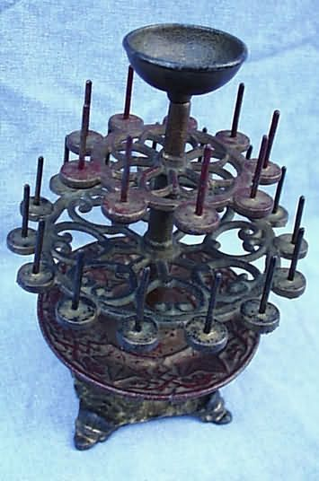 Victorian Cast Iron 2-Tier Thread Stand- Pins to hold 24 spools of thread, bottom tray to hold thimbles or needlework tools, top piece meant to be made into a pincushion.