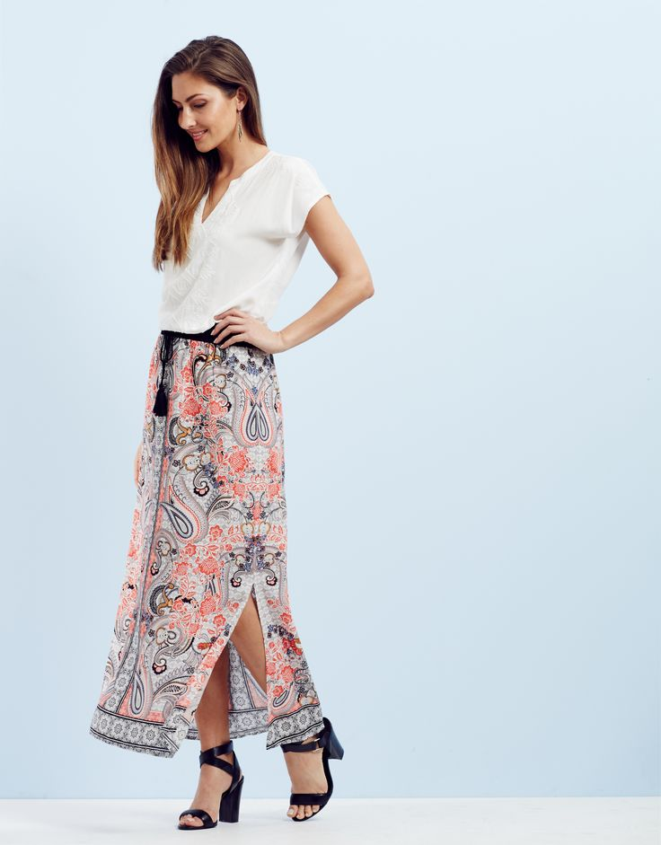 Dressed Up - Add a splash of colour and vibrancy to your look with a statement print maxi skirt. Pair with heels for instant chic.