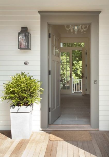 Door: Benjamin Moore Chelsea Gray. HC-168, Siding: Mythic Paint exterior finish in Bell Song. Lantern: Scofield Historic Lighting. Kauffman Tharp Design