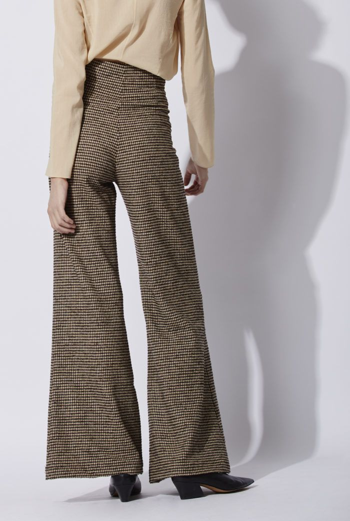 Paolo Pants: High waisted flared woolen tweed pants. The pants have an invisible front zipper. This model can be combined with the Joker top which is made of the same fabric. Made in Barcelona. Cortana AW 2016 collection. Shop online.