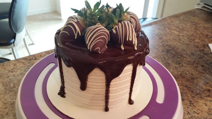 Chocolate Covered Strawberry Cake. Our famous strawberry cake with a deep chocolate base, covered in vanilla buttercream icing, dripping in chocolate ganache and topped with fresh hand dipped chocolate covered strawberries