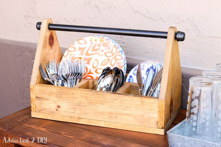 Build this simple rustic industrial dinnerware caddy with some scrap wood and pipe for your next outdoor entertaining event!  #sponsored