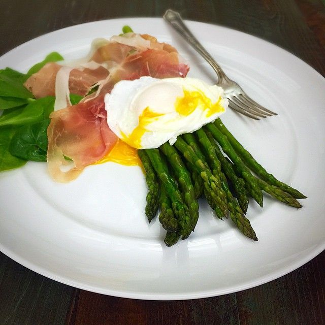 Sautéed asparagus (chop off ends and cook in a sauté pan with some ghee or olive oil until desired tenderness), topped with a poached egg, some pancetta and a handful of fresh spinach on she side. This makes an easy and delicious #paleo side dish, and if you like your yolks runny it acts like a yummy hollandaise sauce. Give it a sprinkle of sea salt and ground black pepper to finish, and Voila!