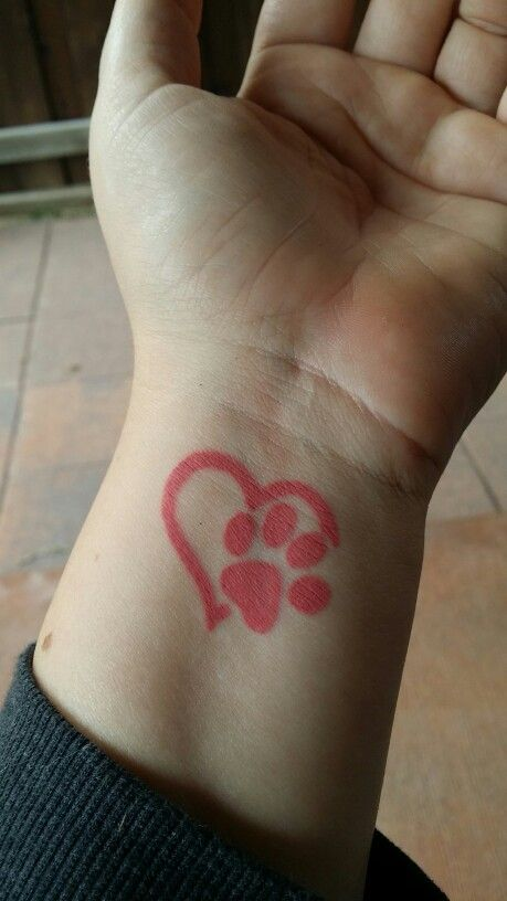 Pink heart with paw print wrist tattoo