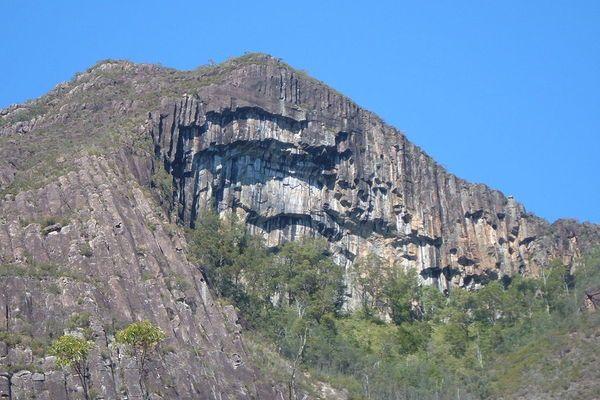 The unique overhanging rock face of Mount Beerwah in Queensland