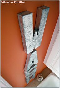 Hobby Lobby cardboard letters painted with metal spraypaint - so light you can hang them with 3m sticky strips!