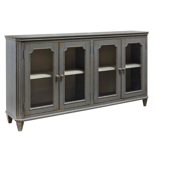 With its distressed vintage paint finish, fluted details and graceful styling inspired by French provincial furniture, this exquisite cabinet puts the accent on très chic living. Adjustable shelved storage is abundantly practical, be it in a dining room, bedroom or entryway. Signature Design by Ashley is a registered trademark of Ashley Furniture Industries, Inc.