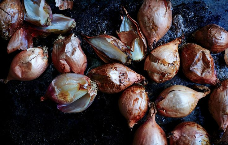 Whole, unpeeled, and roasted to surreal tenderness, shallots are shedding their…