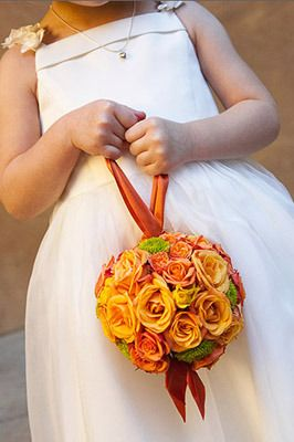 'Kissing Balls' are a great addition to the wedding flowers. They are used often to decorate an aisle, as a centerpiece, or as shown here, for the flower girl to carry!: Flowers Ball, Little Girls, Flowers Bouquets, Kiss Ball, Flowers Girls, Orange Flowers, Orange Rose, Flowers Baskets, Autumn Colors