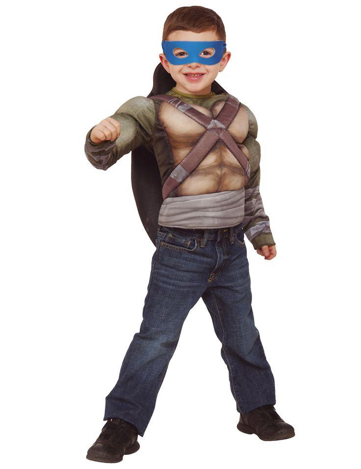 Disfraz Tortugas Ninja™ deluxe musculoso con caparazón: Este disfraz de Tortugas Ninja incluye camiseta, caparazón y 4 antifaces.La camiseta tiene relleno y se cierra con velcro.El caparazón es marrón y se sujeta en la espalda con...