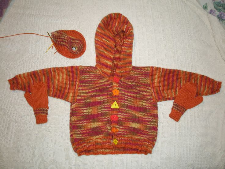 A cardigan, mittens and hat (still in progress) for my niece B's 2nd birthday. She loves orange!