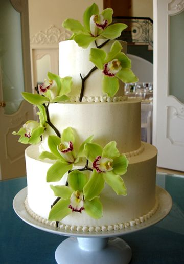 Fresh orchids and chocolate branches.