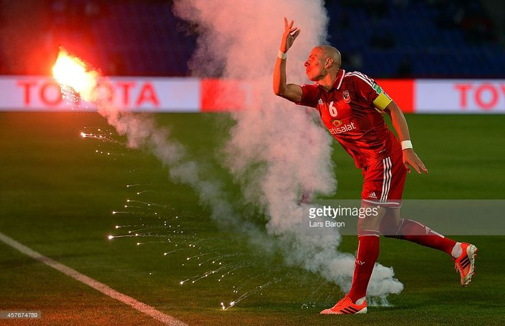 Wael Gomaa of Al Ahly throws a flare away during the FIFA Club World Cup 5th place match between Al Ahly SC and CF Monterrey at Marrakech Stadium on December 18, 2013 in Marrakech, Morocco.