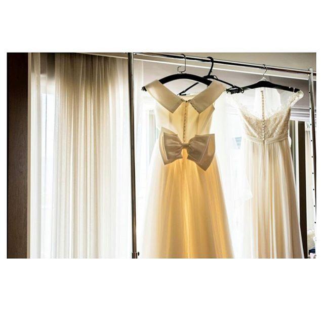 """私の運命のドレスたち…  ミカドシルクのオーダーメイドドレスとReem acraのスレンダードレス。  2泊したので結婚式前夜から一緒に過ごし、眠りました🌛  朝、目覚め""""今日は1日宜しくね♥""""とドレスたちに声を掛けたことも思い出デス…  #卒花#パレスホテル東京#葵西#ミカドシルクドレス#クラシカルドレス#reemacra#ウェディングドレス#クルミボタン#リボン#ビーズ刺繍"""