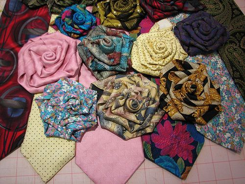 Roses made from vintage ties.- great idea to re-use an old tie, and to save a memory!! I think I am going to find some great ties from my grandpa's and my dad to make Leia some hair roses! What a great memory!!