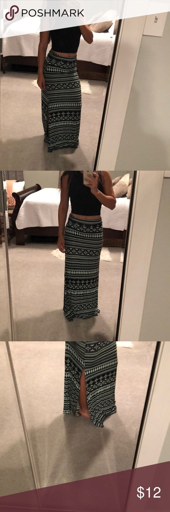 Tribal maxi skirt Turquoise and black tribal maxi skirt, I'm about 5'1 and it's a feel inches too long for flat sandal, would be best to wear with something that hat a little heel. Not see though, nice soft fabric. Optional fold down waist to make it shorter or longer. Charlotte Russe Skirts Maxi