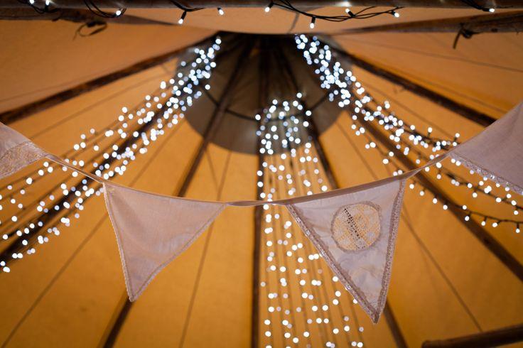 Fairy lights and devonvintagechina.co.uk bunting - worldinspiredtents.co.uk Open Weekend. Image by sarahlaurenphotography.co.uk