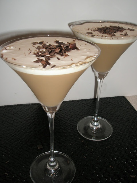 Tiramisu Martini: 1 jigger white or dark rum; 1 1/2 jigger Kahlua; 1/2 jigger Baileys; 1/2 jigger Frangelico; 1/3 tsp of Vanilla extract; 1 jigger cold espresso; 2-3 tablespoons whipped cream; chocolate curls. Pour liqueurs and coffee in a cocktail shaker with ice and shake. Strain into a martini glass. Top martini with whipped cream.