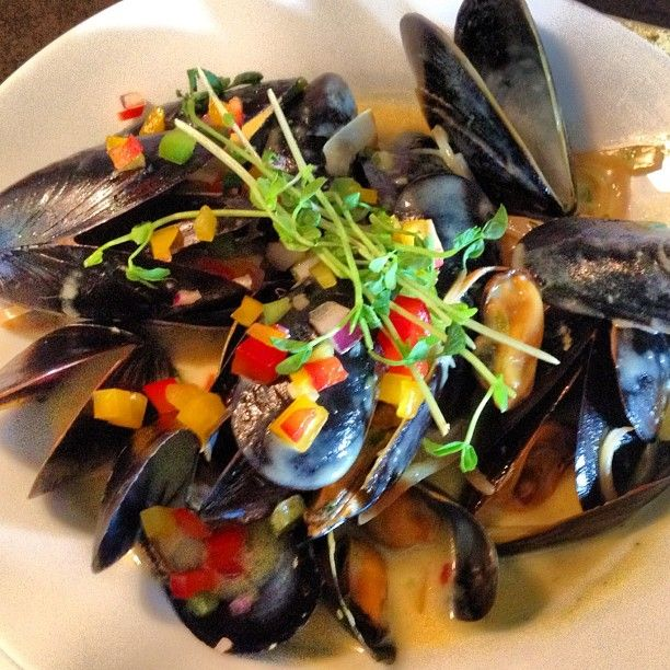 Salt spring mussels steamed in a creamy saffron white wine sauce accompanied by Spanish chorizo.