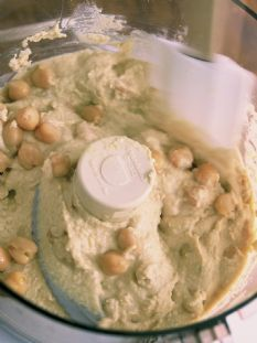 Barefoot Contessa - Recipes - Hummus  Delicious! I left off the tabasco and sprinkled on some smoked paprika. Best hummus I've had in a long time!