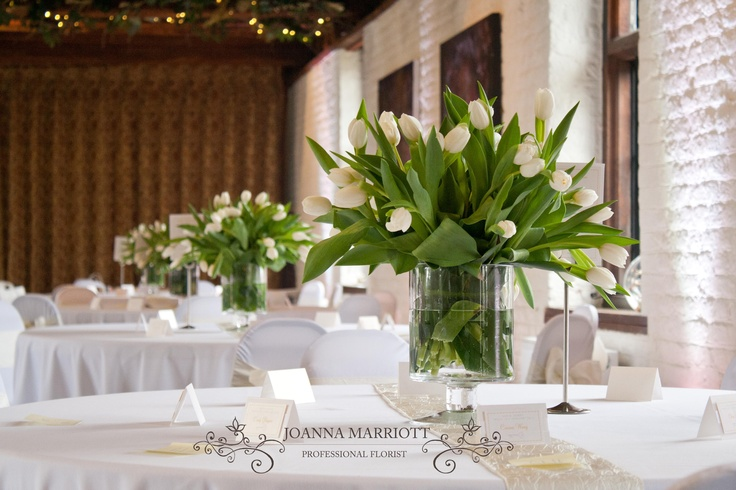 White tulip table arrangements spring wedding for Bridal table arrangements