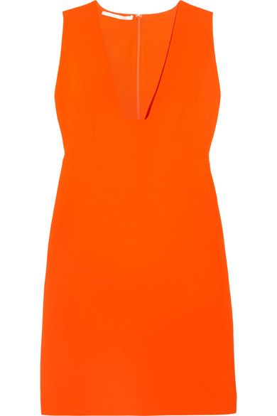 Stella McCartney's dress is cut from smooth stretch-cady in a vivid orange hue. It's fitted at the bodice and flares out into an A-line skirt that mirrors the graphic square V-neckline. Style yours with a low heel to temper the mini length.