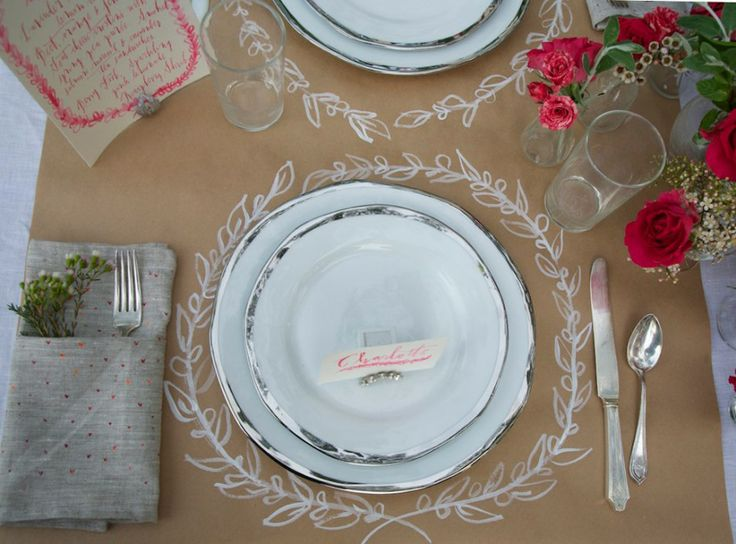 hand-drawn laurel wreath placemats on craft paper