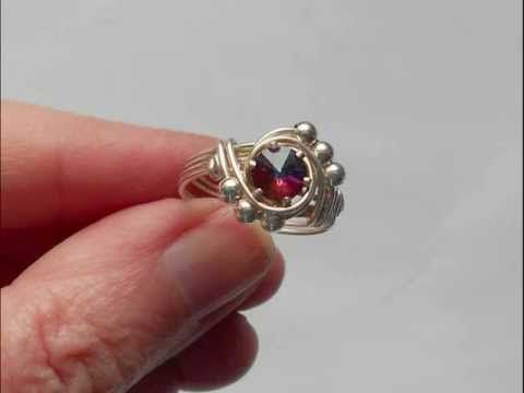 "This is a beautiful, wire wrap ring that is quick and easy to make.  Other tutorials available at www.jewellerytutorials.co.uk  I teach at 'In The Studio'  www.inthestudio.co.uk  Facebook https://www.facebook.com/pages/Wire-Wrap-Jewelry/131079307548    Tools :- Ring Mandrel, Flat faced pliers, Snips, Measure  Materials :- 2 x Approx 8"" (this makes up ..."
