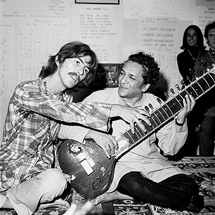 "George Harrison and Ravi Shankar playing a sitar. Harrison often practiced eight hours a day while in India. ""George's passion for the music amazed me,"" Shankar said."