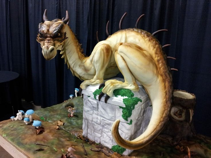 Sculpted cake for the 2012 Austin cake show took 1st.  It was about 40 inches high and 50 inches long, this dragon was made mostly out of cake ( just box mix) with minimal use of styrofoam for the underside of the support structure and a small amount of rice crispy treats around the bottom of the legs and a layer on top of the carverd cake  thigh for extra stability and girth. The dragon was covered using fondant and then airbrushed for detail and color.