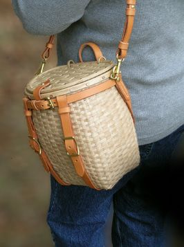 Maine Packbasket Purse worn at side - brown ash, brass, leather - by Stephen Zeh