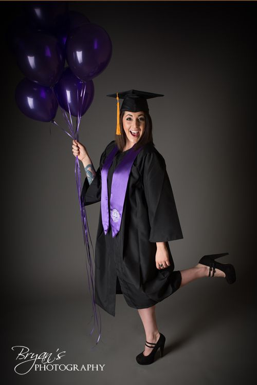 Senior Photography in cap and gown with balloons. Photo by Bryan's Photography…