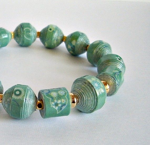 paper bead bracelet - after the devastating fire for the peole living in the humongous Guatemala City dump, Safe Passage taught the ladies to make these and support their families. Beautiful....