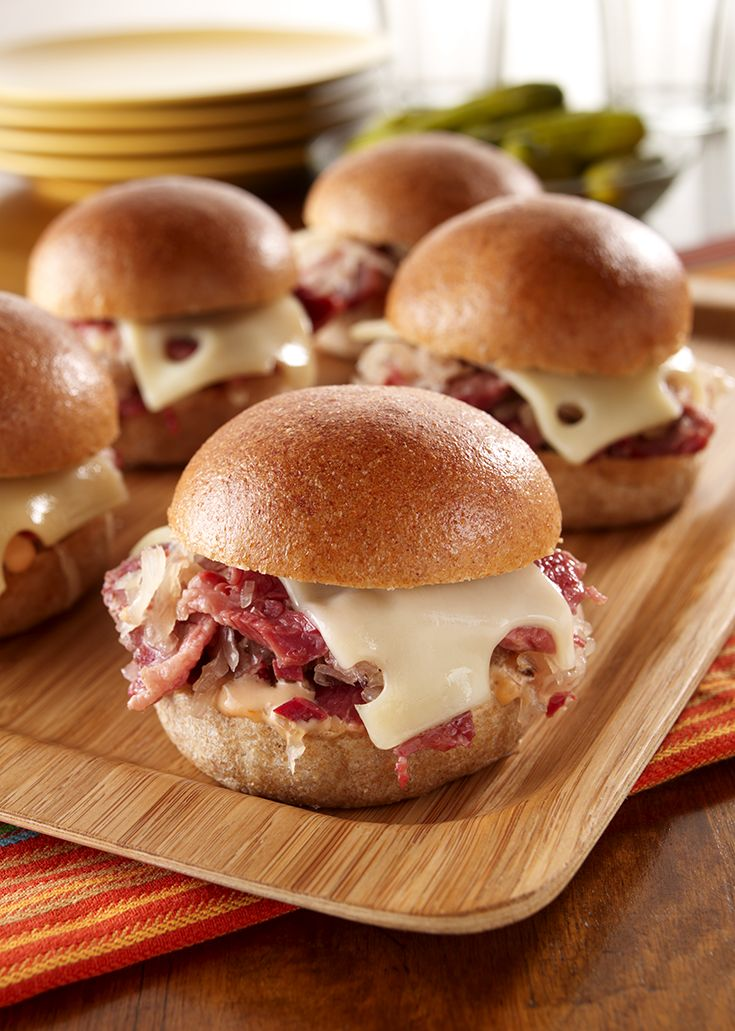 Cook beef brisket in beer and onion for a tender, juicy slider, topped with cheese and thousand island dressing.