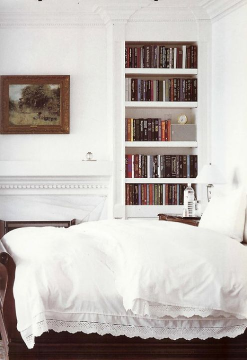 Lots of white with a few, wooden accents. I love a built-in book case, especially this one, that's discrete and make the books center of attention.