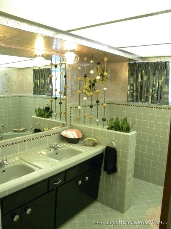 A Glorious Pale Green Vintage Bathroom With A Black Vintage Cabinet. Lots  Of Pale Green Tile Goodness.