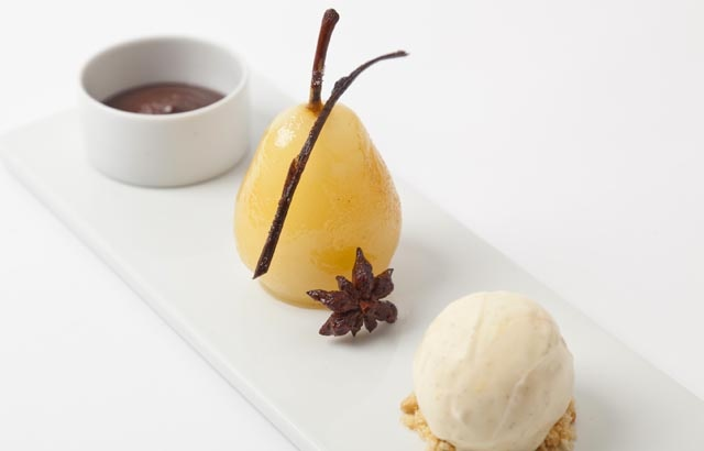 Spiced poached pears with hot chocolate sauce and vanilla ice cream.  A marvellous dessert.